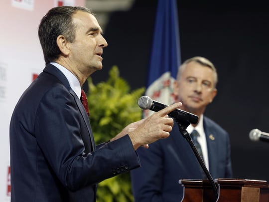 Democratic candidate for governor, Lt. Gov. Ralph Northam, left, gestures during a debate with Republican challenger Ed Gillespie at the University of Virginia-Wise.