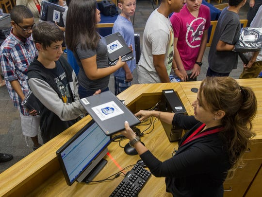 At the start of school in 2016, students pick up their Chromebooks for the year.