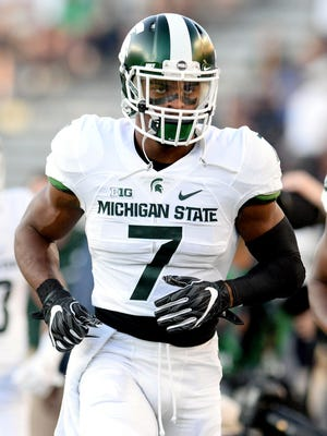 Michigan State University  senior defensive back Demetrious Cox (7) runs out onto the field before the Spartans game against Notre Dame Saturday, Sept. 17, 2016 in South Bend, Ind.