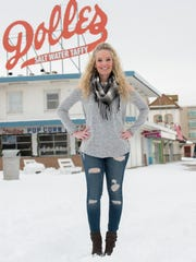 """Allison Griffith Sullivan wears a gray Neely cold shoulder sweater; Nordstrom plaid infinity scarf; and vintage Destroyed Denim jeans, """"an awesome Marshalls find."""""""
