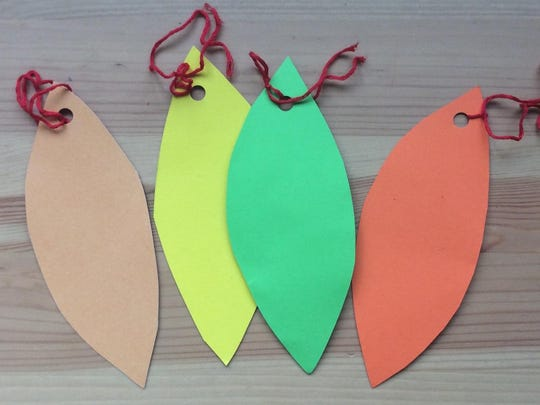 Make leaves out of colored construction paper that can be tied to branches in a vase and labeled with words of gratitude.