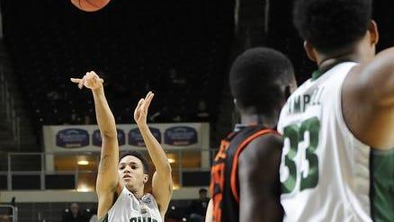 Ohio University freshman Jordan Dartis from Newark unloads a 3-pointer against Bowling Green on Jan. 12 in Athens. Dartis set a Bobcat record for best 3-point percentage.