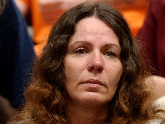 Deborah Hulett sits in Boone County District Court during arraignment in 2002.