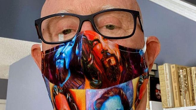 A.T. Hun Gallery owner Chuck Hamilton in one of the Gildersleeve masks.