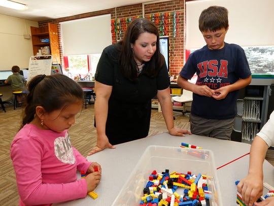 First grade technology teacher Randi Nerkizian, center,