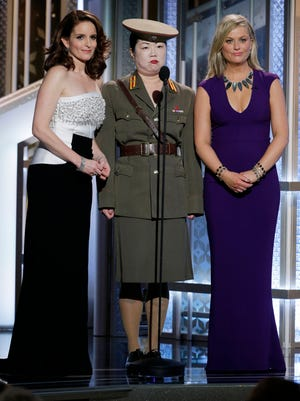 Tina Fey,  Margaret Cho and  Amy Poehler speak onstage during the 72nd Annual Golden Globe Awards.