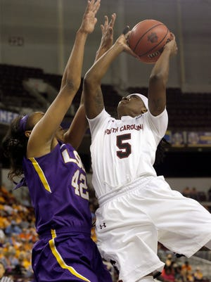 South Carolina's Khadijah Sessions (5) shoots against LSU's Sheila Boykin (42) in the second half of a Southeastern Conference tournament semifinal NCAA college basketball game, Saturday in North Little Rock, Ark. South Carolina defeated LSU 74-54.