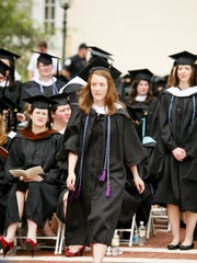 Brittany Baker walks up to receive a Master of Arts