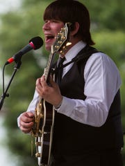 Robert Murray as George Harrison, performs with his Beatles Tribute Band: Studio Two Sunday afternoon during the Abbey Road on the River music festival. May 25, 2015.