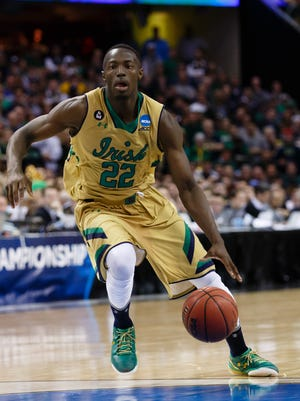 Mar 28, 2015: Notre Dame Fighting Irish guard Jerian Grant (22) dribbles against the Kentucky Wildcats in the finals of the midwest regional of the 2015 NCAA Tournament at Quicken Loans Arena.