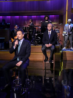"""Host Jimmy Fallon, left, speaks and former Governor Jeb Bush, right, the new Republican presidential candidate, appears during """"Slow Jam the News"""" on """"The Tonight Show Starring Jimmy Fallon,"""" Tuesday, June 16, 2015, in New York. Bush is being featured Tuesday on the """"Tonight"""" show's recurring """"slow jam the news"""" skit with host Fallon. The job requires the former Florida governor to recite lines while Fallon, stylized as a 1970s soul man, offers a double entendre. (Douglas Gorenstein/NBC via AP)"""