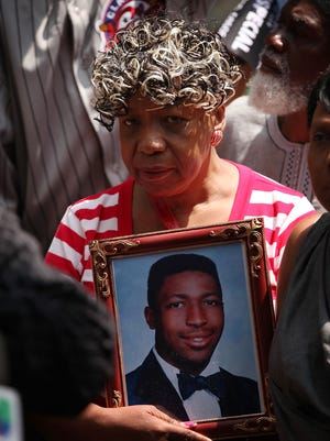 Gwen Carr, the mother of Eric Garner, holds a picture of her son at a rally in New York on July 7, 2015.