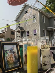File photo of a memorial set up outside a Long Branch home where authorities believe a man fatally shot his common-law wife and their two children before turning the gun on himself in 2015.