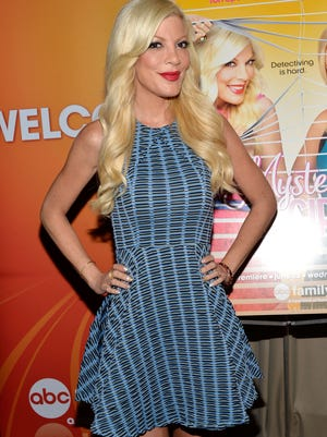 "Actress Tori Spelling attends the ""Mystery Girls"" Screening hosted by The Moms at Park Avenue Screening Room on June 24, 2014 in New York City."