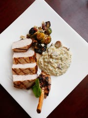 The pork chop with risotto and Brussels sprouts at the English Grill.