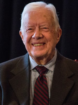 Former president Jimmy Carter has said his cancer, which had spread to his brain, is in remission.