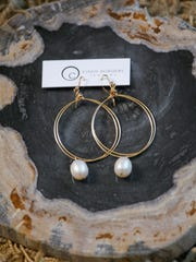 Gold circle earrings with freshwater pearls by Cindy Borders. Dec. 4, 2015