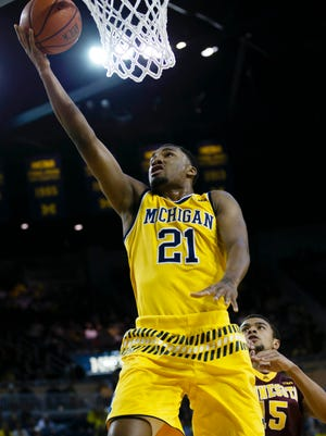 Michigan guard Zak Irvin goes to the basket in the first half of U-M's win Wednesday.