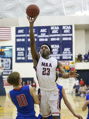 MRA's Devin Gilmore (23) hits a shot in the lane.