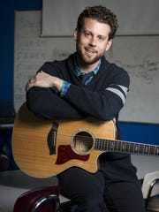 Music education teacher Michael Walton in his classroom at DuPont Hadley Middle School.
