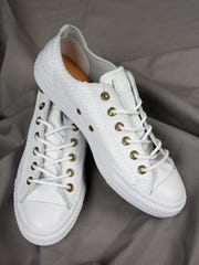 Here's a version of that traditional Converse that shows off in white leather. $70 at Von Maur, Oxmoor Centre