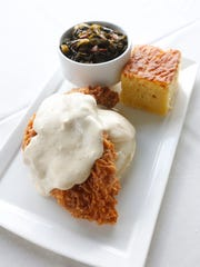 Fried chicken with whipped potatoes, braised kale,