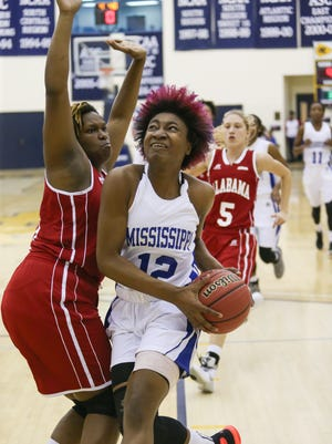 Heidelberg's Nique Cherry  drives for a shot as Alabama's Katelynn Thomas (13) guards on the play. Cherry had 17 points and 10 rebounds to lead Mississippi to victory in the Mississippi-Alabama All-Star basketball game Friday at A. E. Wood Coliseum.