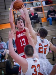 Fredericktown's Kirk Manns led the area in scoring this season and is being courted by colleges in basketball and baseball.