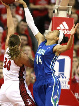 VERMILLION, SD, APRIL 2:  Margaret McCloud (30) from the University of South Dakota has her shot blocked by FGCU's Whitney Knight (14) during the WNIT Championship game Saturday afternoon at the Dakota Dome in Vermillion, S.D. (Photo by Dave Eggen/Inertia)