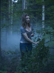 "This photo provided by Gramercy Pictures shows Natalie Dormer as Sara Price in Jason Zada's ""The Forest,"" a Gramercy Pictures release. The movie opens in U.S. theaters on Jan. 8, 2016. (James Dittiger/Gramercy Pictures via AP)"