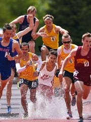 Runners participate in the men's 3,000-meter steeplechase during the 2016 NSIC Outdoor Track and Field Championships Saturday, May 14, 2016, at Howard Wood Field in Sioux Falls.