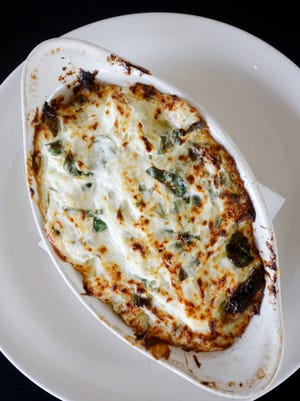 The artichoke spinach dip served at Sam's Food and Spirits at Highlander Point.