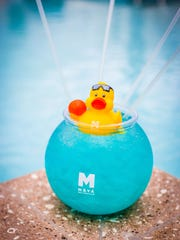 The Deep Blue Fish Bowl cocktail adds a bit of whimsy