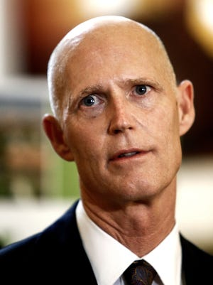 Gov. Rick Scott addresses a small crowd about his proposed cell phone and television tax cut at the Bonita Springs Area Chamber of Commerce on Wednesday, February 4, 2015. (Scott McIntyre/Staff)
