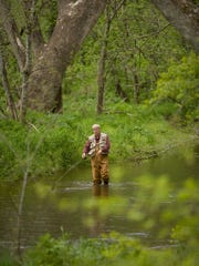 A lone angler after trout in Crane Creek.