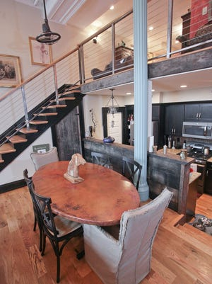 A view the dining area and mezzanine from the living room at the home of John and Deborah Shurlow-Parson in NuLu.