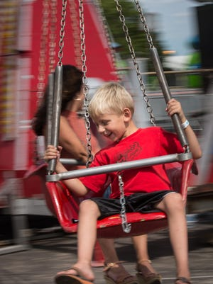 Carter Zick has fun on one of the midway rides at the Winnebago County Fair.