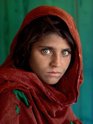 'Afghan Girl' is a famous photograph by Steve McCurry (b. 1950) shot in  Peshawar, Pakistan in 1984. It is an archival  pigment print work, the centerpiece of a show by the artist at the Michener Museum in Doylestown.,