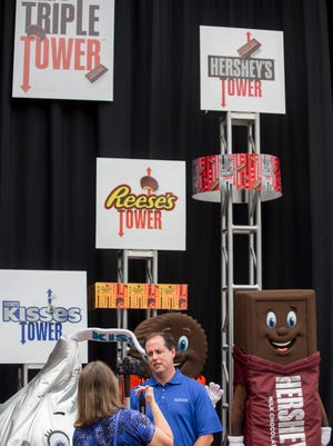 Kevin Stumpf, General Manager Attractions & Entertainment at Hersheypark announces the Triple Tower, the new ride for the 2017 season, Aug. 2, 2016 at the park in Hershey, Pa. (Mark Pynes/PennLive.com via AP)