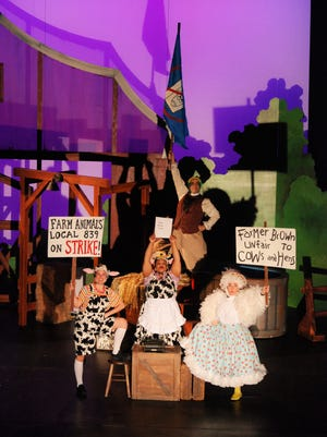 "Cami Glauser, Janelle Dunn, Ben Evanns and Jessie Alagna portray the striking animals on Farmer Brown's barn in the musical ""Click, Clack, Moo: Cows That Type"" in the musical from StageOne Family Theatre."