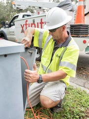 A Comcast technician works to restore service in Tallahassee.
