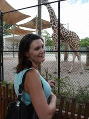 Emily Leugers takes in the giraffes at the Naples Zoo. The BT Hero House this week hosted the first veteran's family on Marco to come for a vacation after an overseas deployment.