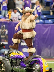 Minnesota Vikings mascot Ragnar gets fans excited before a game in 2011.
