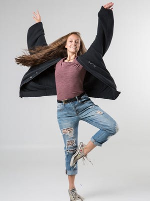 """""""I like these Converse because I practice ballet in them and they're broken in perfectly,"""" said Imogen Cooper, a tenth grader at Atherton High School. """"They also have people protesting on them, which is a current but subtle statement."""""""