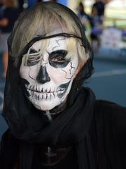 City of Marco Island recreation manager Lola Dial showed her true colors, or lack of same. Hundreds of costumed characters showed up for the annual Halloween Spooktacular, held Saturday afternoon at Mackle Park.