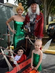 Philip and Lauren Osborne, with children Myles and Raelyn, went all-out on their Neverland theme, with two Capt. Hooks, two Tinkerbelles, and a wagon transformed into a pirate ship. Hundreds of costumed characters showed up for the annual Halloween Spooktacular, held Saturday afternoon at Mackle Park.