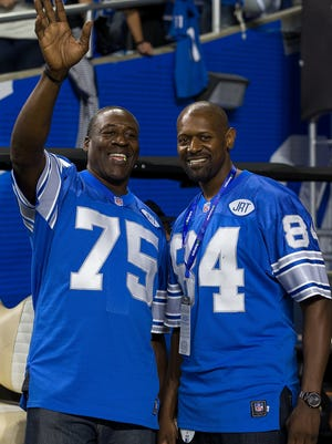 Former tackle Lomas Brown, left, and former receiver Herman Moore of the Detroit Lions visit the sidelines before a game between the Lions and Los Angeles Rams at Ford Field on Oct. 16, 2016.