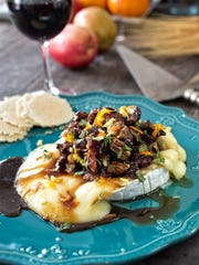 Baked brie with apples, cherries and pecans.