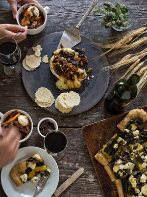 Baked brie with apples, cherries and pecans, Fall pizza with acorn squash, broccoli rabe, kale, mushrooms, sage, brown butter, sage on sourdough crust and chocolate mousse with meringue cookies and persimmon.