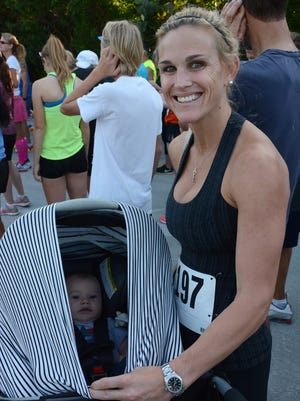 Overall female winner Lauren Bogan with her running mate, Tommy, age 4 months. The 4th Annual Marco Island Kiwanis Family 5k was held Saturday morning, starting and ending at Tigertail Beach and running through Hideaway Beach.